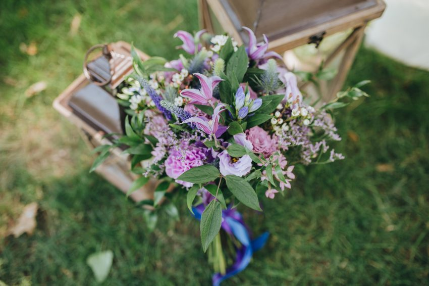 bridal bouquet of flowers and greenery is in the area for a wedding ceremony