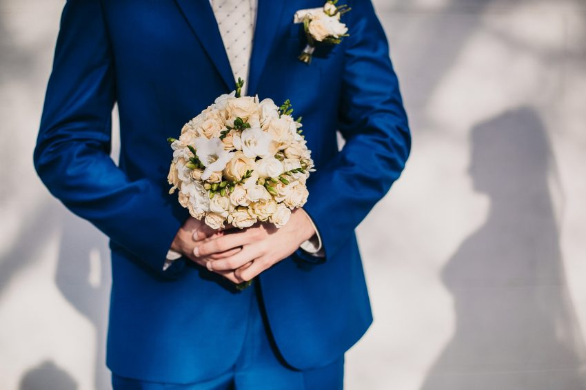 bridegroom holding a bouquet