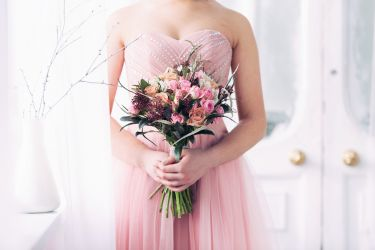 bridal bouquet from pink roses in hands